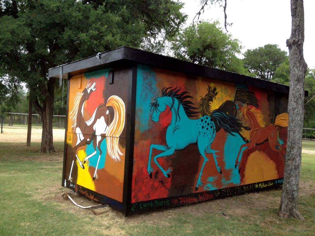 The Beer Barn Mural.  I painted this with the help of a troop of Girl Scouts. It is a building in a park in Elgin, Tx (concession stand - hence the name).  All 4 sides are painted.